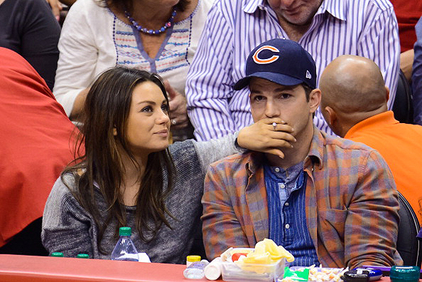 LOS ANGELES, CA - MARCH 22:  Mila Kunis (L) and Ashton Kutcher attend a basketball between the Detroit Pistons and the Los Angeles Clippers at Staples Center on March 22, 2014 in Los Angeles, California.  (Photo by Noel Vasquez/GC Images)