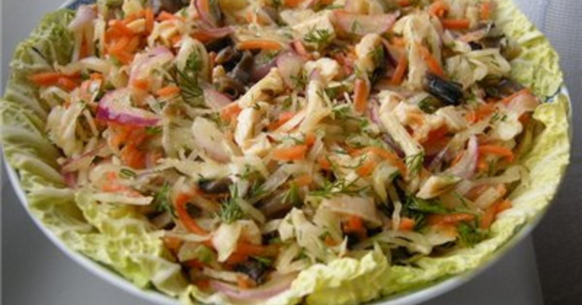 Салат из кальмаров с квашеной капустой
