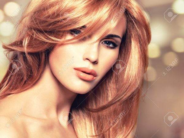 Portrait of a beautiful woman with long straight red hair