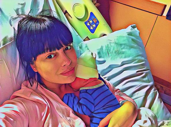 Нелли с новорожденным сыном