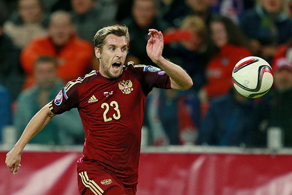 Известный футболист во время матча
