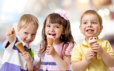 funny children group kidding with ice cream on party