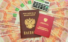 Pension certificate data sheet and calculator on the background of the Russian money