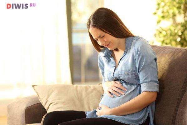 Почему болит живот на ранних сроках беременности